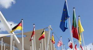 Waving flags against the blue Lisbon sky